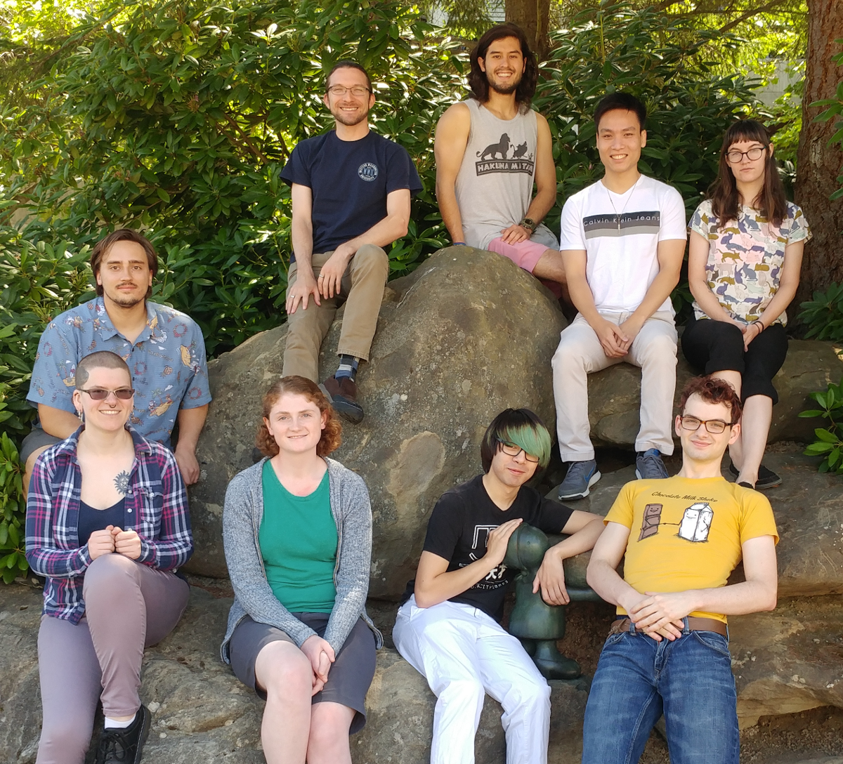 a group of students pose on and around a boulder Summer 2017
