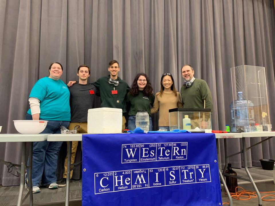 image of chem club behind table at event