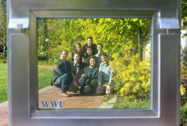 students stand behind solar window at wwu